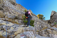 Hiker on via ferrata Stock Photo