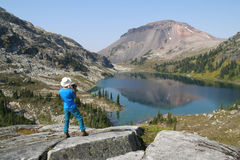 Hiker with Video Camera Above Ring Lake Royalty Free Stock Photography