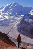 Hiker viewing glacier royalty free stock photography