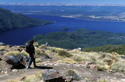 Hiker viewing Lake Te Anau. A hiker pauses on the Kepler Track to take in the view of Lake Te Anau, Fiordland, New Zealand Royalty Free Stock Photo