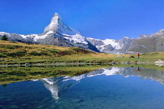 Hiker viewing Matterhorn. Hiker beneath Matterhorn at Leisee (lake), Zermatt, Switzerland Royalty Free Stock Photos