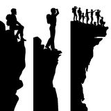 Hiker viewpoints. Three editable vector side panel silhouettes of hikers standing on top of a cliff or outcrop with all people as separate objects Stock Images