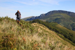 Hiker visiting basque country mountains Royalty Free Stock Photo