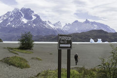 Hiker walking across sandbar Grey Lake, Torres del Paine, Chile Royalty Free Stock Photography