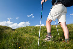 Hiker walking along a mountain path. royalty free stock image