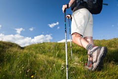 Hiker walking along a mountain path. stock images