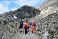 Hiker walking along a path at Grossglockner Mountain and Pasterz Stock Image