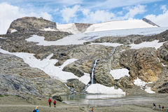 Hiker walking along a path at Grossglockner Mountain and Pasterz Stock Photography