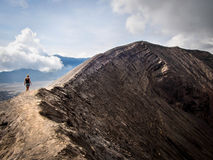 Hiker Walking Around Rim of Gunung Bromo Volcano, Java, Indonesi Stock Photography