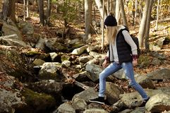 Hiker walking in autumn forest in the mountains. Hiking and traveling. Hiker walking in autumn forest in the mountains. Hiking, camp, adventure, traveling and Royalty Free Stock Photos