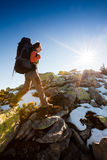 Hiker walking in autumn mountains Stock Images