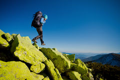 Hiker walking in autumn mountains Royalty Free Stock Image