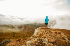Hiker walking in autumn mountains Royalty Free Stock Photos