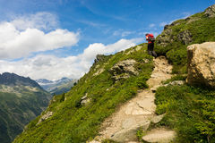 Hiker walking on a beautiful path in Aiguilles Rouges Royalty Free Stock Photos