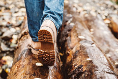 Hiker walking in boots closeup Stock Images