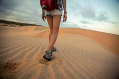 Hiker walking in the desert Royalty Free Stock Image