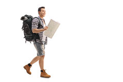 Hiker walking and holding a generic map Stock Photos