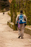 Hiker walking in a man made trail Royalty Free Stock Photos