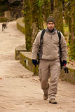 Hiker walking in a man made trail Royalty Free Stock Photo
