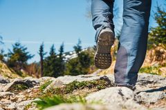Hiker walking on path in the mountains Royalty Free Stock Images