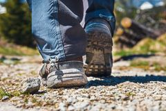 Hiker walking on path in the mountains Royalty Free Stock Image
