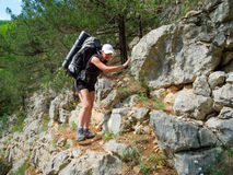 Hiker walking on a rocky path Royalty Free Stock Photos