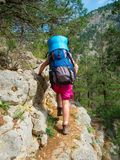 Hiker walking on a rocky path Stock Photo