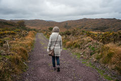 Hiker walking through rugged wild landscape Stock Photography