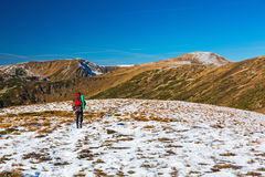 Hiker walking on Snow Slope Trail Mountains View Royalty Free Stock Photography
