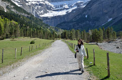 Hiker walking to the cirque of Gavarnie Royalty Free Stock Image