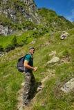 Hiker walking to the mountain peak Royalty Free Stock Photos