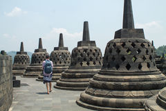 Hiker walking at the top of borobudur temple in central Java, In. Yogyakarta - September 06, 2016: Hiker walking at the top of borobudur temple in central Java Stock Photography