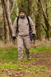 Hiker walking a trail Stock Photography