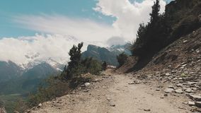 Hiker walking on trekking trail in Nepal. With Panoramiv View of Annapurna Mountain stock footage