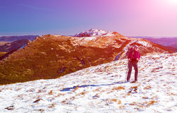Hiker walking up on Snow Slope Mountains View with Sun Royalty Free Stock Images