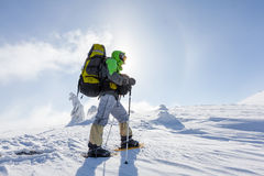 Hiker walking in winter Carpathian mountains Royalty Free Stock Photography
