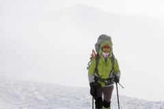 Hiker walking in winter Carpathian mountains Stock Photo