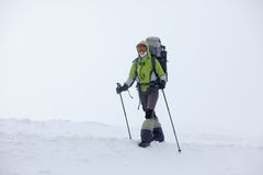 Hiker walking in winter Carpathian Royalty Free Stock Image