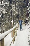 A hiker walking on a winter hiking trail Stock Photos