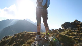 Hiker walks along narrow summit ridge crest, Outstetches Arms stock video