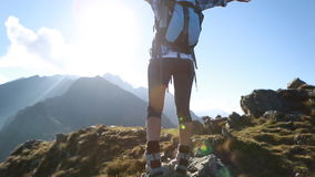 Hiker walks along narrow summit ridge crest, Outstetches Arms stock video footage