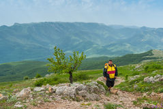 Hiker walks through Chatyr-Dah mountainous massif in Crimean mountains Stock Photos