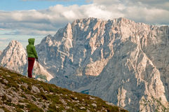 Hiker watching mountains. A girl hiker watching mountains royalty free stock photos