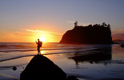 Hiker Watching Sunset Over the Ocean Surf. Stock Image
