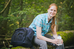 Hiker with Water Bottle Resting Stock Photography