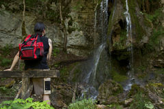 Hiker at a waterfall Stock Images