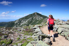 Hiker on way to summit Royalty Free Stock Image