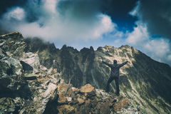 Hiker welcome beautiful mountain valley. Instagram stylization Stock Photo