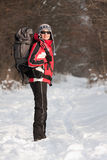 Hiker in winter forest Stock Photo