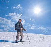 Hiker on a winter hill Stock Photo